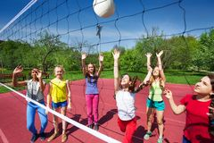 Volleyball game with playing teenage children Royalty Free Stock Photography