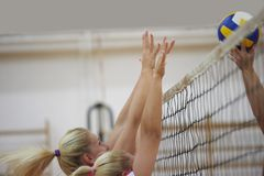 Volleyball. Game sport with group of young beautiful girls indoor in sport arena school gym stock photos