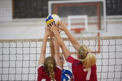 Volleyball. Game sport with group of young beautiful girls indoor in sport arena school gym stock photo