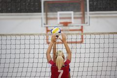 Volleyball. Game sport with group of young beautiful girls indoor in sport arena school gym stock image