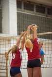 Volleyball. Game sport with group of young beautiful girls indoor in sport arena school gym royalty free stock photo