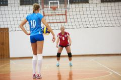 Volleyball. Game sport with group of young beautiful girls indoor in sport arena school gym royalty free stock image