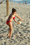 Volleyball Girl. Woman in a red bikini playing beach volleyball Royalty Free Stock Image