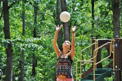 Volleyball girl. Young girl practicing volleyball hits Royalty Free Stock Images