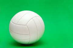 Volleyball on green. White volleyball isolated on the green background Royalty Free Stock Images