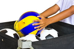 Volleyball in hand and football. Royalty Free Stock Photography
