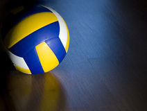 Volleyball on hardwood floor. A professional volleyball lying on a hardwood floor royalty free stock images