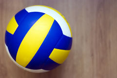 Volleyball on hardwood floor stock photography