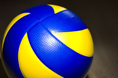 Volleyball on hardwood floor Stock Images