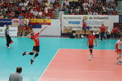Volleyball match european ligue. Match volleyball between two europeans teams with supporters, with spanish seleccion team Royalty Free Stock Photography