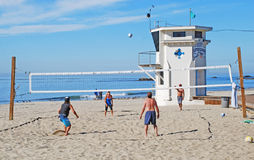 Volleyball near Lifeguard Tower, Laguna Beach, CA. Image shows a volleyball game being played near the iconic Lifeguard Tower on the Main Beach of Laguna Beach Royalty Free Stock Photography