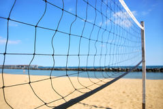 Volleyball net. Beach volleyball net in perspective on a sandy beach stock images