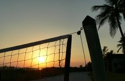 Volleyball net. Sunset viewed through beach volleyball net stock images