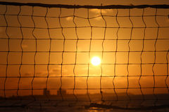 Volleyball net. Detailed look at the volleyball net at sunset Royalty Free Stock Photo