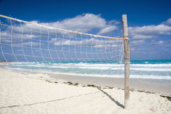 Volleyball net. On a empty sunny beach royalty free stock photo