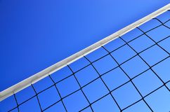 Volleyball net against the blue sky Stock Images