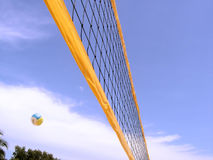 Volleyball net with ball. Volleyball net with a volleyball in the air. Shot at a tropical beach Royalty Free Stock Photos