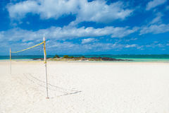 Volleyball net and on the beach Stock Photos