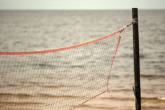 Volleyball net on the beach close-up. Stock Photo