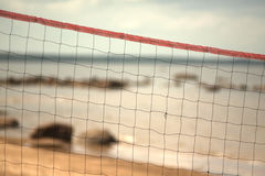 Volleyball net on the beach close-up. Royalty Free Stock Photography