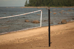 Volleyball net on the beach close-up. Stock Photos