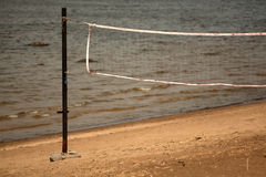 Volleyball net on the beach close-up. Stock Images