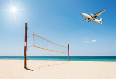 Volleyball net on the beach and plane Royalty Free Stock Image