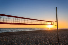 Volleyball net on the beach. With the sunset Royalty Free Stock Photo