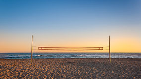 Volleyball net on the beach. With the sunset Stock Images