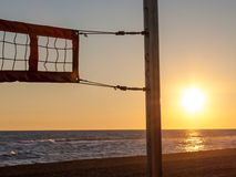 Volleyball net on the beach. With the sunset Royalty Free Stock Photos