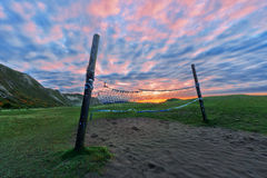 Volleyball net on the beach at sunset Royalty Free Stock Images