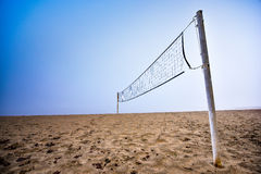 Volleyball net on a beach in thick fog on the Ottawa River. Royalty Free Stock Images