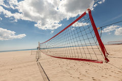 Volleyball net at the beach Stock Photos