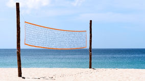 Volleyball net at beach. A volleyball net on beach with blue sea, clear and sunny sky Stock Images