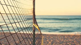 Volleyball net and beautiful sunrise on the beach.  stock footage