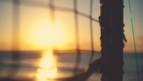 Volleyball net and beautiful sunrise on the beach.  stock video footage