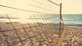 Volleyball net and beautiful sunrise on the beach.  stock video