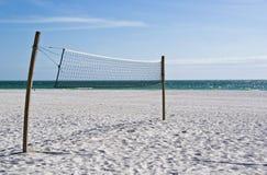 Volleyball net on an empty beach. Beach volleyball net on an empty stretch of beach Royalty Free Stock Photos