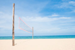 Volleyball net on empty sand beach Stock Photo