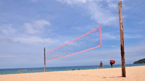 volleyball net on empty sand beach with blue sky stock video footage