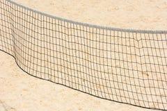 Volleyball net on empty sand beach Stock Photos