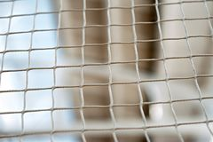 Volleyball net, in the gym. Close-up, in a covered room, Boke. Volleyball net, in the gym. Close-up, in a covered room. Boke royalty free stock photo