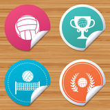 Volleyball and net icons. Winner award cup. Round stickers or website banners. Volleyball and net icons. Winner award cup and laurel wreath symbols. Beach sport Stock Photos