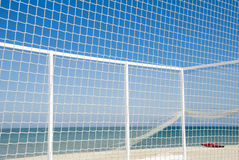 Volleyball net with red boat on the beach Royalty Free Stock Photos