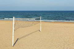 Volleyball net on sand at the beach Stock Photos