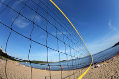 Volleyball net on a sandy beach, detail Stock Photos