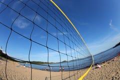 Volleyball net on a sandy beach, detail Stock Photos