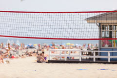 Volleyball net on sandy beach, summertime play Royalty Free Stock Image