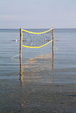 Volleyball net on the sea. Water Stock Image