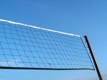 Volleyball net with sky. Taken with the sky through its net, the empty sky also emphasizes the texture of the ropes. It also looks like a long flag, blank space Royalty Free Stock Images
